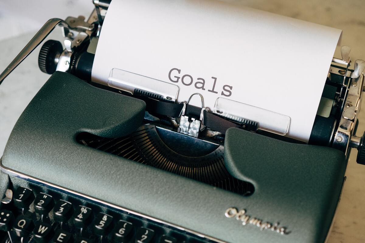 A page is in the black typewriter with text goal wrote on it